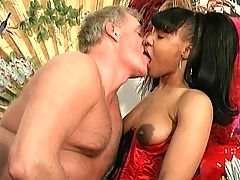 Hot ebony in corset getting a good rough fuck
