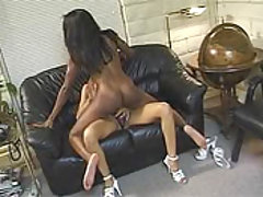 A pretty black babes lesbian lover fucks her with a strap on