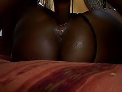 After fucking her ebony pussy deep with his fuck stick, he pulls out and shoots a load of cum on her black ass